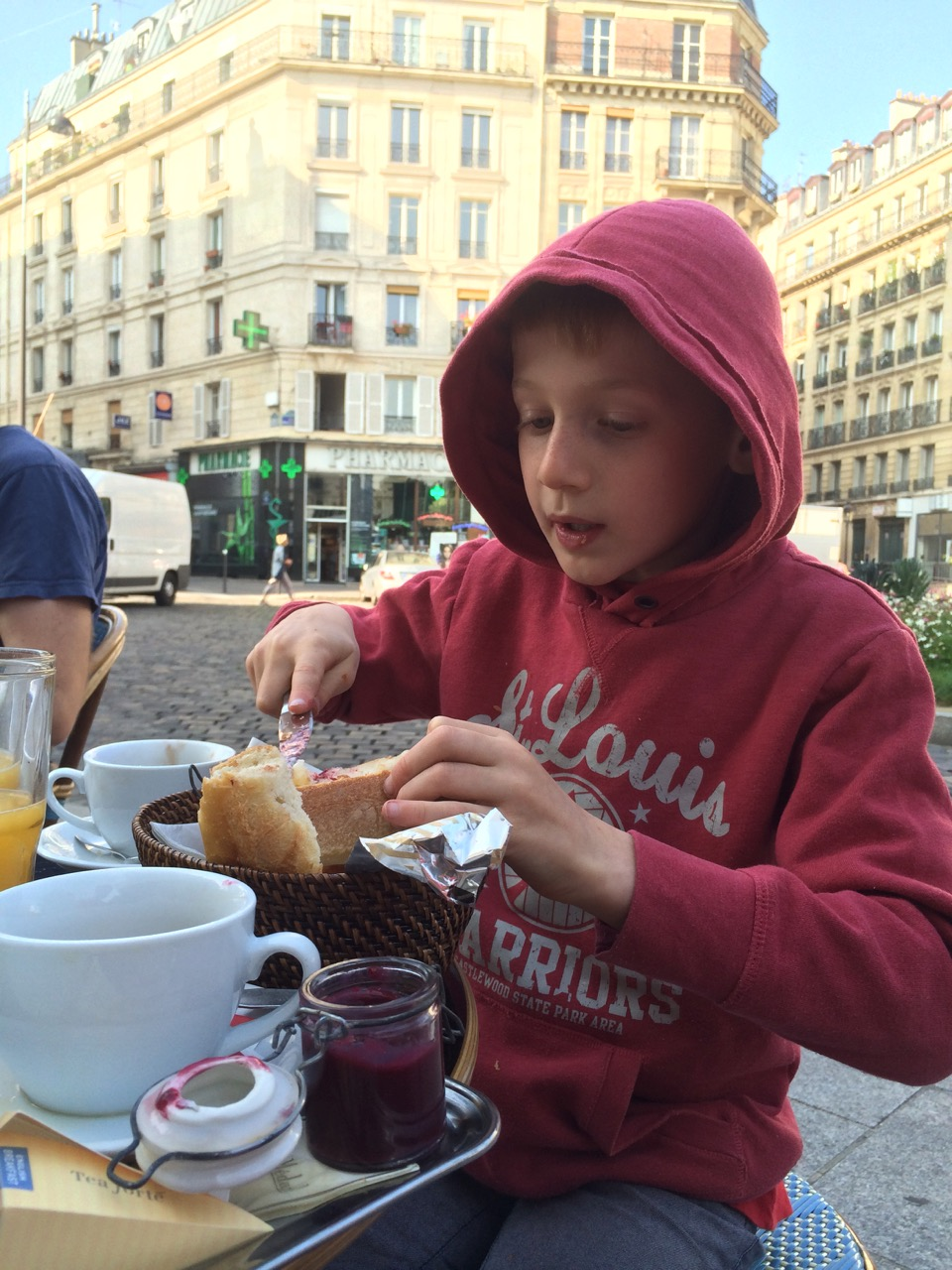Oliver eating petite dejeuner in Paris