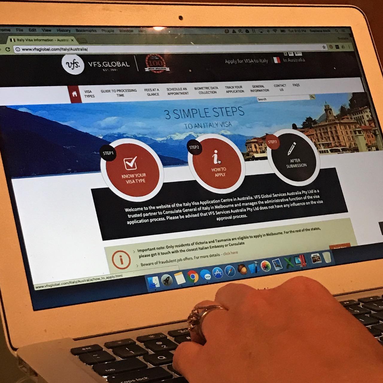 Visa website on laptop screen
