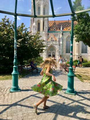 Spinning outside the colourful church on Buda Hill