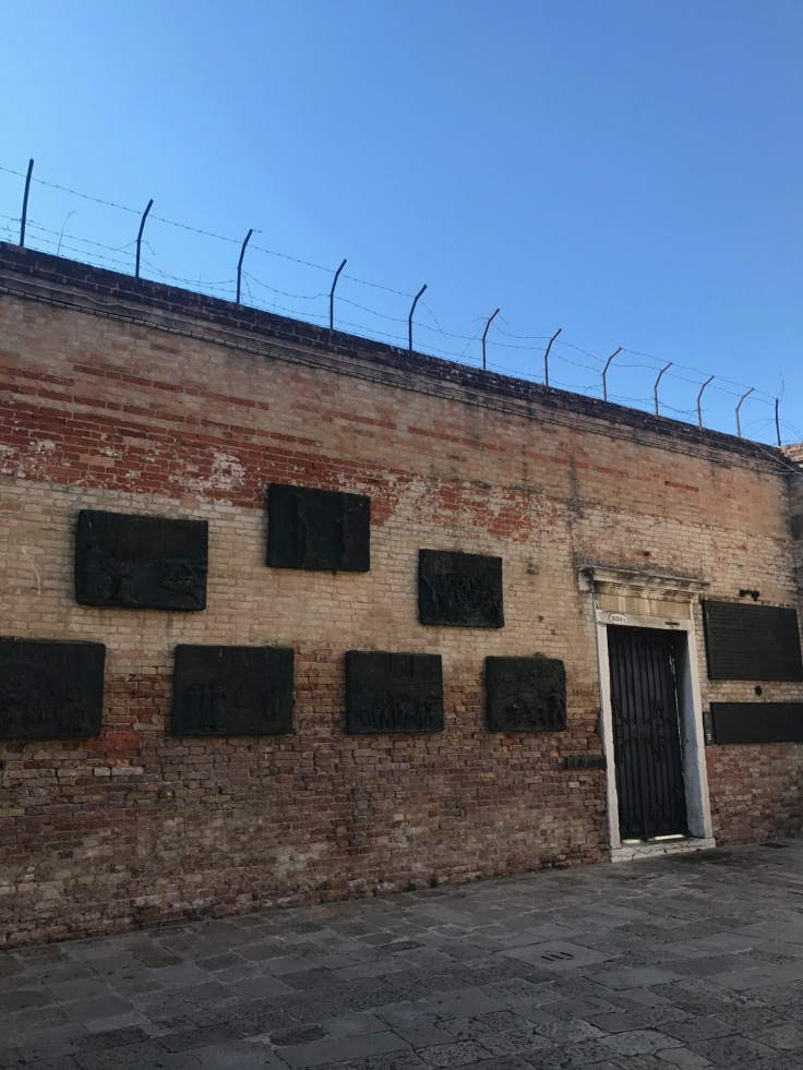 Bronze plates recalling the history of the area adorn a wall that once would have fenced in Venice's Jewish population.
