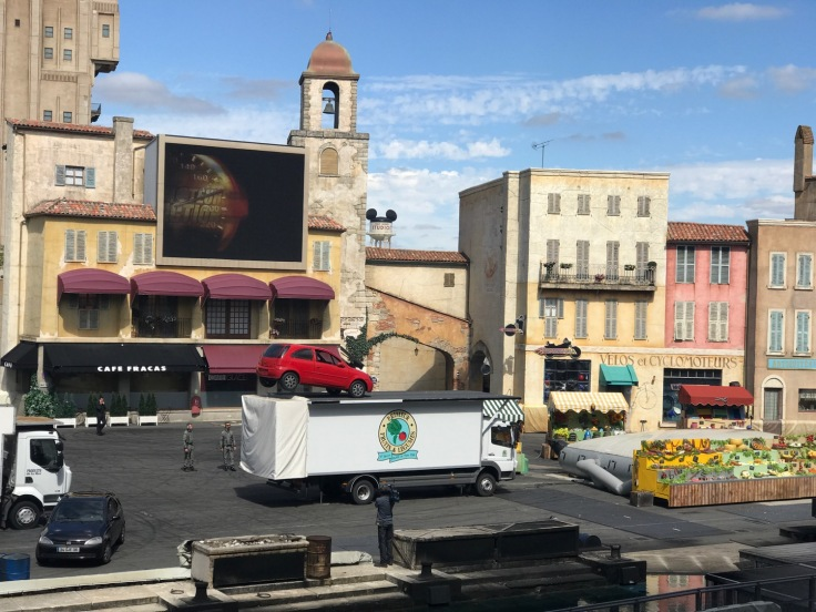 A car leaps onto a truck during the stunt show