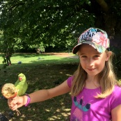 Feeding parrots in Hyde Park